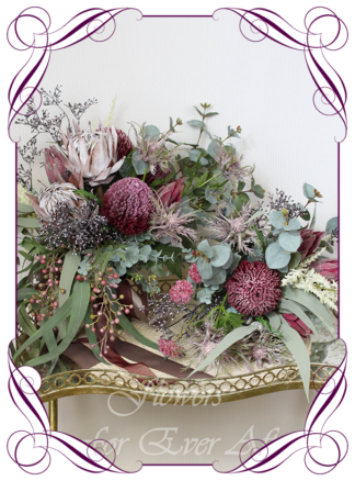 Realistic artificial bridal flowers, silk flower rustic native Australian bridal bouquet, burgundy banksia fake flower posy, protea, gum leaves cascading posy bridal bouquet. Made in Melbourne. Shipping world wide. Buy online