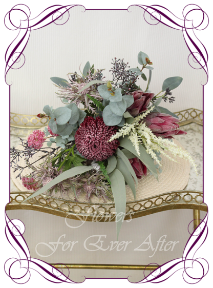 Realistic silk artificial fake flower rustic native Australian burgundy banksia, protea, gum leaves cascading posy bridal bouquet. Made in Melbourne. Shipping world wide. Buy online