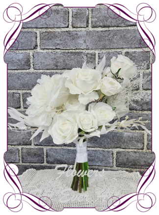 Silk white bridesmaid flowers, artificial white floral wedding bouquet, boho whimsical bridal wedding flowers. Roses, peony, protea, phalaenopsis moth orchids, reflex roses. Romantic elegant wedding flowers. Made in Melbourne Australia. Buy online, post worldwide.