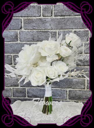 Silk white bridesmaid flowers, artificial white floral wedding bouquet, boho whimsical bridal wedding flowers. Roses, peony, protea, phalaenopsis moth orchids, reflex roses. Romantic elegant wedding flowers. Made in Melbourne Australia. Buy online, post worldwide.