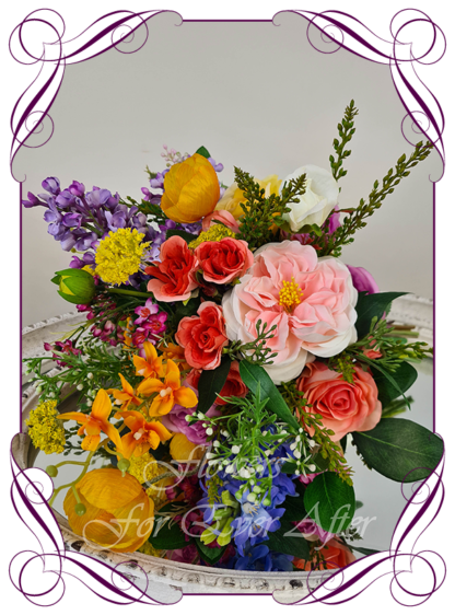 Silk wedding flowers artificial bridal bouquet in vibrant colourful silk flowers. Colorful spring flowers with gum foliage, orchids, roses, poppies, ranunculus. Pink, yellow, orange, blue, lilac, wedding flowers. Made in Melbourne Australia by Australia's best silk florist.