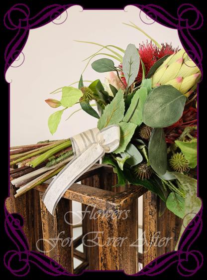Silk bridal bouquet, artificial wedding flowers red green navy Australian native wedding flowers bridal bouquet. Protea, gum flowers, roses, succulent, kangaroo paw, navy blue wattle. Made in Melbourne Australia by Australia's best silk florist.