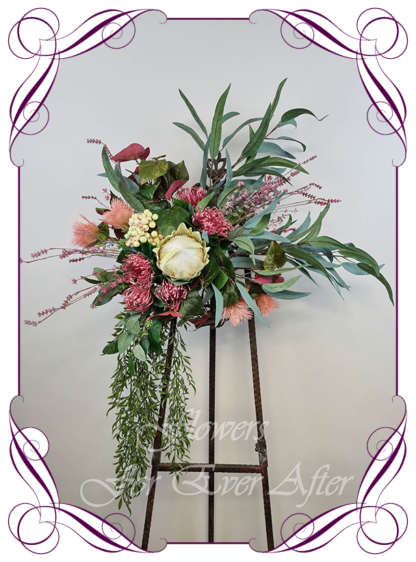 Realistic silk artificial fake flower rustic native Australian raspberry burgundy protea, gum leaves cascading arbor corner arch decoration wedding decor. Made in Melbourne. Shipping world wide. Buy online