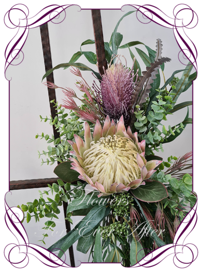 Realistic silk artificial fake flower rustic native Australian blush pink king protea, mauve purple banksia gum leaves cascading arbor corner arch decoration wedding decor. Made in Melbourne. Shipping world wide. Buy online