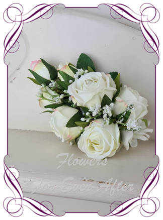 Silk artificial floral white ivory roses ladies corsage.. Roses, baby's breath, pinned or wrist corsage. Flowers for Mother of the bride, mother of the groom, formal, prom.. Made in Melbourne Australia. Buy online, post worldwide.