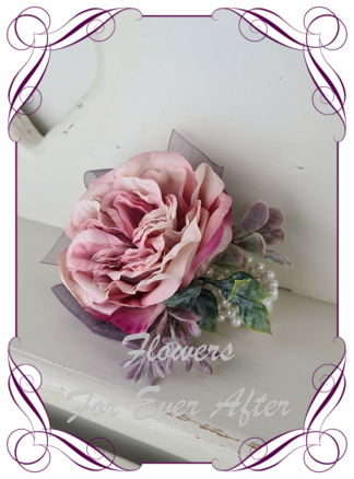 Silk artificial elegant pink and plum purple rose wrist corsage on pearls for wedding prom formal. Unusual wedding flowers, unusual corsage flower, mother of the bride flowers, mother of the groom flowers. Made in Melbourne by Australia's best silk florist. Buy online. Shipping worldwide