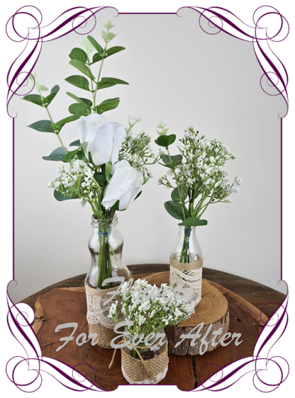 Silk artificial white roses and baby's breath and eucalypt gum bunch cluster table centrepiece decoration. Wedding table florals. simple white wedding rustic table centrepiece. Made in Australia. Buy online. Shipping world wide