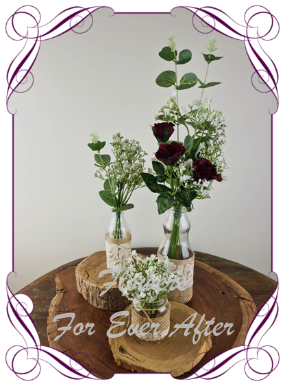 Silk artificial burgundy roses and baby's breath and eucalypt gum bunch cluster table centrepiece decoration. Wedding table florals. simple white wedding rustic table centrepiece. Made in Australia. Buy online. Shipping world wide