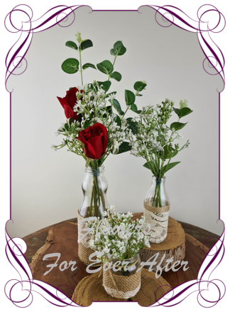 Silk artificial red roses and baby's breath and eucalypt gum bunch cluster table centrepiece decoration. Wedding table florals. simple white wedding rustic table centrepiece. Made in Australia. Buy online. Shipping world wide