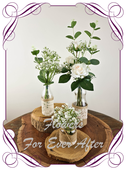 Silk artificial champagne blush roses and baby's breath and eucalypt gum bunch cluster table centrepiece decoration. Wedding table florals. simple white wedding rustic table centrepiece. Made in Australia. Buy online. Shipping world wide
