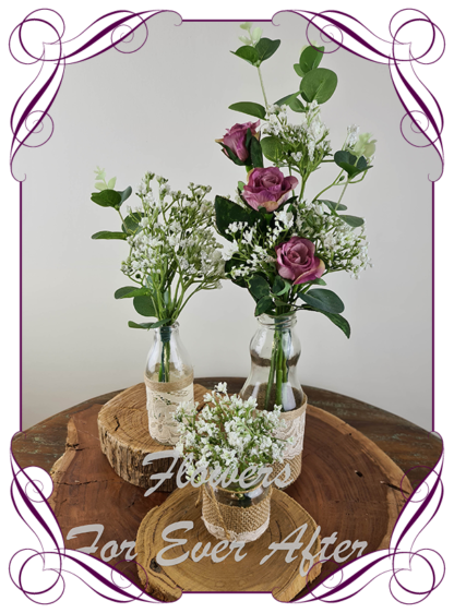 Silk artificial dusty rose pink roses and baby's breath and eucalypt gum bunch cluster table centrepiece decoration. Wedding table florals. simple white wedding rustic table centrepiece. Made in Australia. Buy online. Shipping world wide