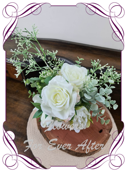 Silk artificial white and sage table centrepiece decoration. Wedding table florals. simple wedding rustic table centrepiece with white roses, peonies, blue gum, sage leaves. Australian native gum leaves. Made in Australia. Buy online. Shipping world wide
