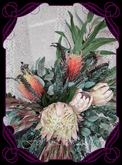 Realistic silk artificial fake flower rustic native Australian blush pink king protea, burnt orange banksia gum leaves cascading arbor corner arch decoration wedding decor. Made in Melbourne. Shipping world wide. Buy online