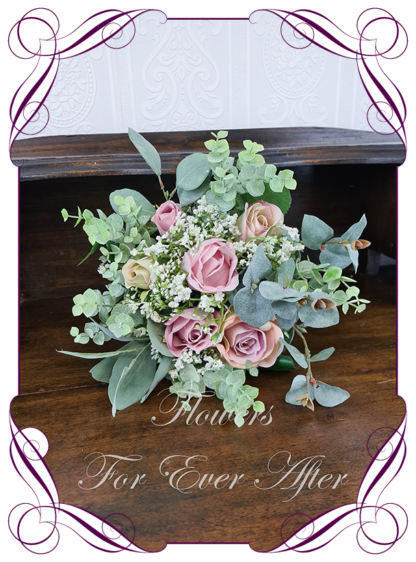 A Gorgeous Silk Artificial pastel and pink roses and Baby's Breath Bridal Bouquet posy, featuring faux flowers Australian native blue gum leaves in a romantic elegant and unusual bridal style, blush pink wedding flowers, native rustic wedding, boho flowers, traditional wedding bouquets. Made in Melbourne by Australia's Best Artificial Bridal Florist. Worldwide Shipping available