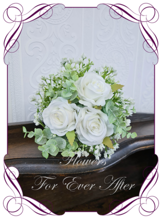 A Gorgeous Silk Artificial white roses and Baby's Breath flower girl Bouquet posy, featuring faux flowers Australian native blue gum leaves in a romantic elegant and unusual bridal style, classic white wedding flowers, native rustic wedding, boho flowers, traditional wedding bouquets. Made in Melbourne by Australia's Best Artificial Bridal Florist. Worldwide Shipping available