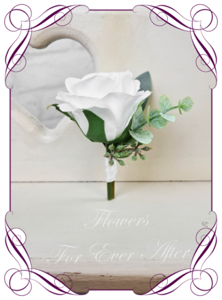 silk artificial gents mens button grooms groomsmans page boy boutonniere for wedding and formal / prom. White classic elegant rose silk flowers, with Australian native gum leaf foliage and seed design. Made in Melbourne Australia. Buy online, shipping world wide.