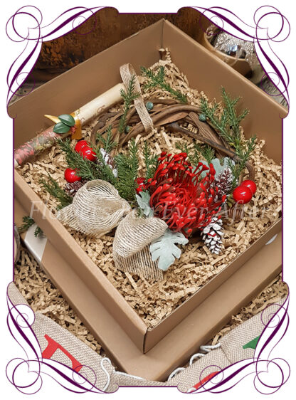 Christmas Floral wreath gift Hamper, artificial silk flowers by melbournes best wedding florist. Amazing christmas wreaths with personalised message and added gift. Melbournes best silk bridal florist. Delivery worldwide.