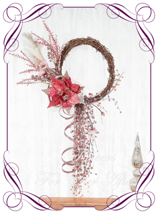Rose gold pink Artificial floral Christmas wreath for door or wall, featuring artificial rose pink poinsettia, pampas and artificial foliage's. Made by Melbourne's Best Silk Bridal Florist creating unique artificial wedding flower packages. Delivery worldwide. Custom orders welcome.