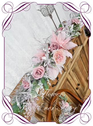 Pink White Artificial floral Christmas Garland Centrepiece for table décor or mantel, featuring artificial pink poinsettias, silk roses and artificial foliage's. Made by Melbourne's Best Silk Bridal Florist creating unique artificial wedding flower packages. Delivery worldwide. Custom orders welcome.