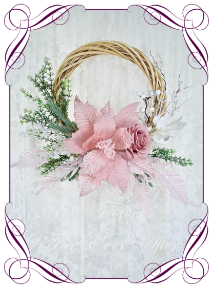 Pink White Artificial floral Christmas wreath for door or wall, featuring artificial pink poinsettias, silk roses and artificial foliage's. Made by Melbourne's Best Silk Bridal Florist creating unique artificial wedding flower packages. Delivery worldwide. Custom orders welcome.