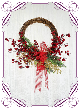 Red & Gold Artificial floral Christmas wreath for door or wall, featuring artificial red flowers and artificial foliage's. Made by Melbourne's Best Silk Bridal Florist creating unique artificial wedding flower packages. Delivery worldwide. Custom orders welcome.