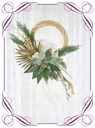 Green Gold Artificial floral Christmas wreath for door or wall, featuring artificial green poinsettias, gold palm, berries and artificial foliage's. Made by Melbourne's Best Silk Bridal Florist creating unique artificial wedding flower packages. Delivery worldwide. Custom orders welcome.